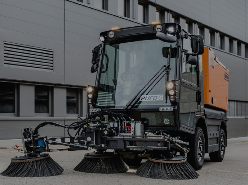 Compact sweeper